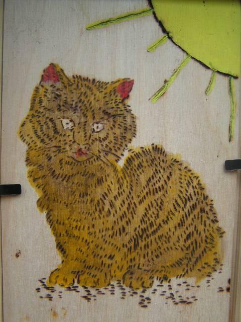 К книге выжигание по дереву котенок